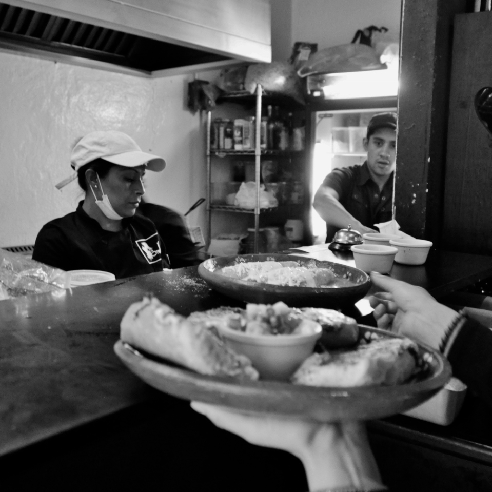 Looking over the shoulder of one of the waiters at the Canalla's restautrant, in Mexico City's historic center.