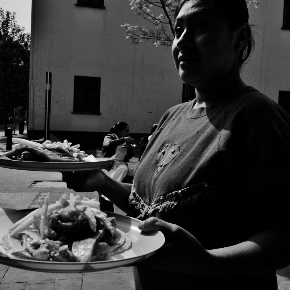 Waiters often make for great street photography subjects. First of all because they can't really get away from tjhe pesky photographer, but mostly because they are proud of the great food they are serving up.