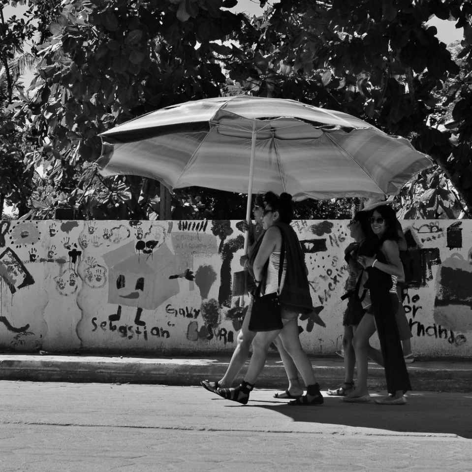 These pierced, tattooed ladies seemed so happy marching down the street with their huge parasol, that i didn't have the heart to tell them it could actually be folded for carrying.
