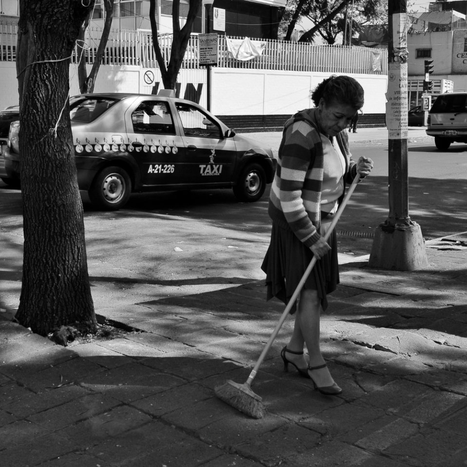 Mexico city street sweepers do a fairly good job, but as the old saying goes: if you want something done well, you'd better do it yourself. This lady was sweeping the pavement prior to setting up an outdoor roadside restaurant.