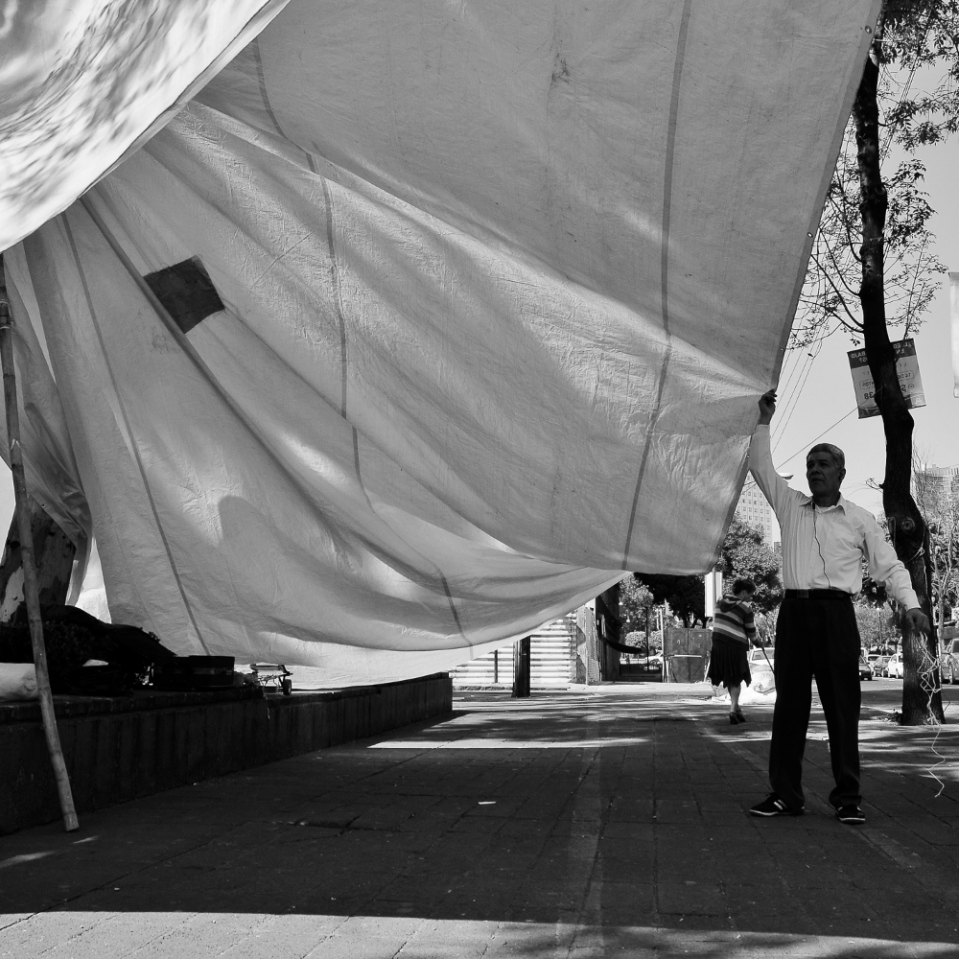 ...and this is the husband of the lady in the first photo. He was busy making a temporary roof for his restaurant by tethering a large tarp from the tree branches.