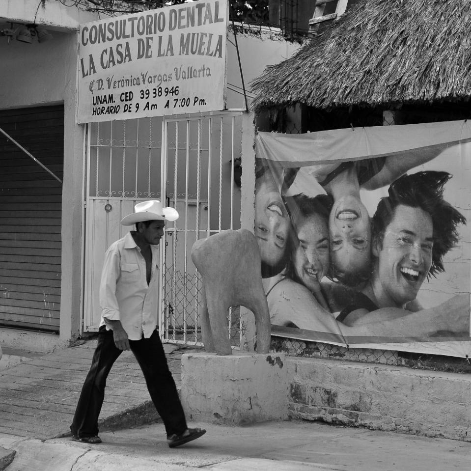 "The huge concrete molar marks the ""casa de la muela"", literally: home of the dental cavity."