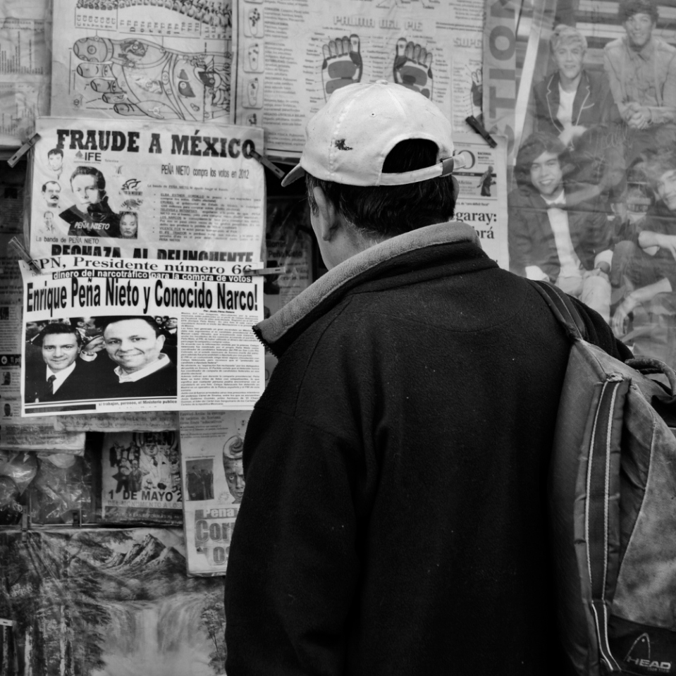 """""""Fraude a Mexico"""" - the large headline on a paper clearly dissatisfied with the new president - clearly tickled this guy's curiosity..."""
