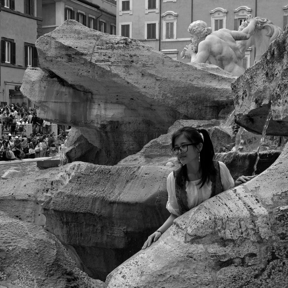 Graceful pose at Trevi fountain.