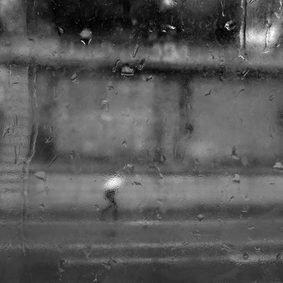 Unhappy in the rain, shot from a city bus, Via Nazionale, Rome.