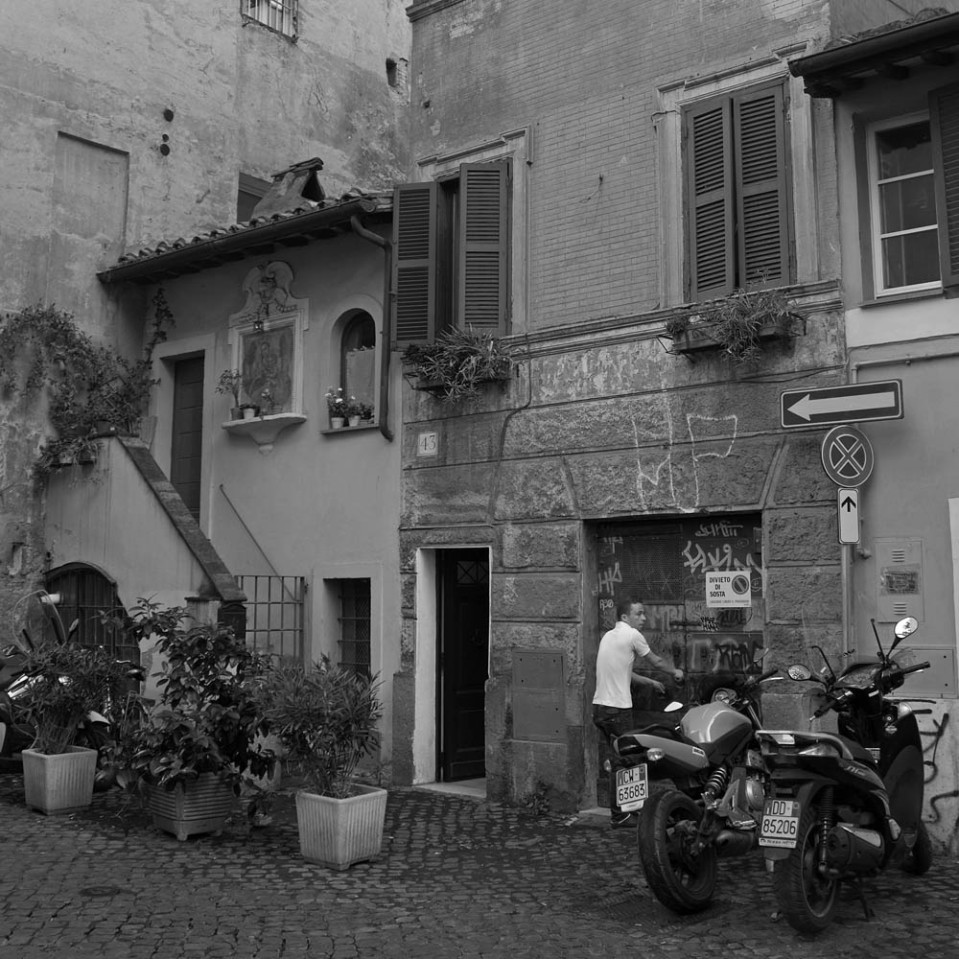 Trastevere: tiny houses, potted plants and motorcycles everywhere.