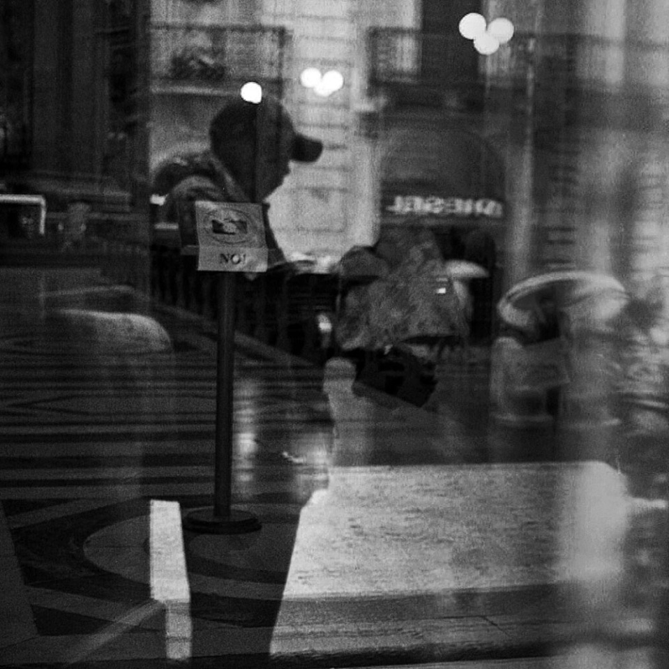 Looking into a church on Via del Corso. The man checking the map is actually behind me, reflected in a glass door.