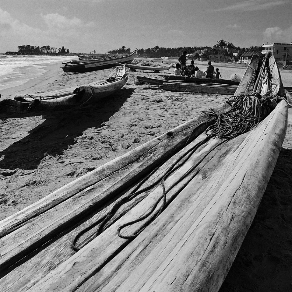 Traditional long fishing boats made by tying logs together, as these at Mamallapuram, are gradually being replaced by more modern fiberglass craft.