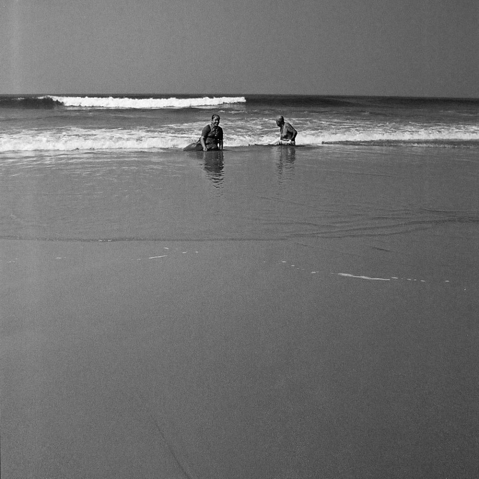 Peace at high noon: elderly couple wallowing in the warm waters at Palolem, Goa.