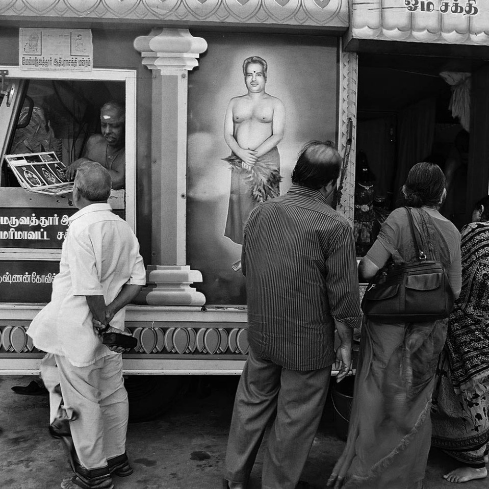 Not sure if this was a temple-in-a-truck or a shrine-on-wheels, but the man in the driver's cabin - who also featured prominently painted on the side - was a big hit with the locals. Kanyakumari.