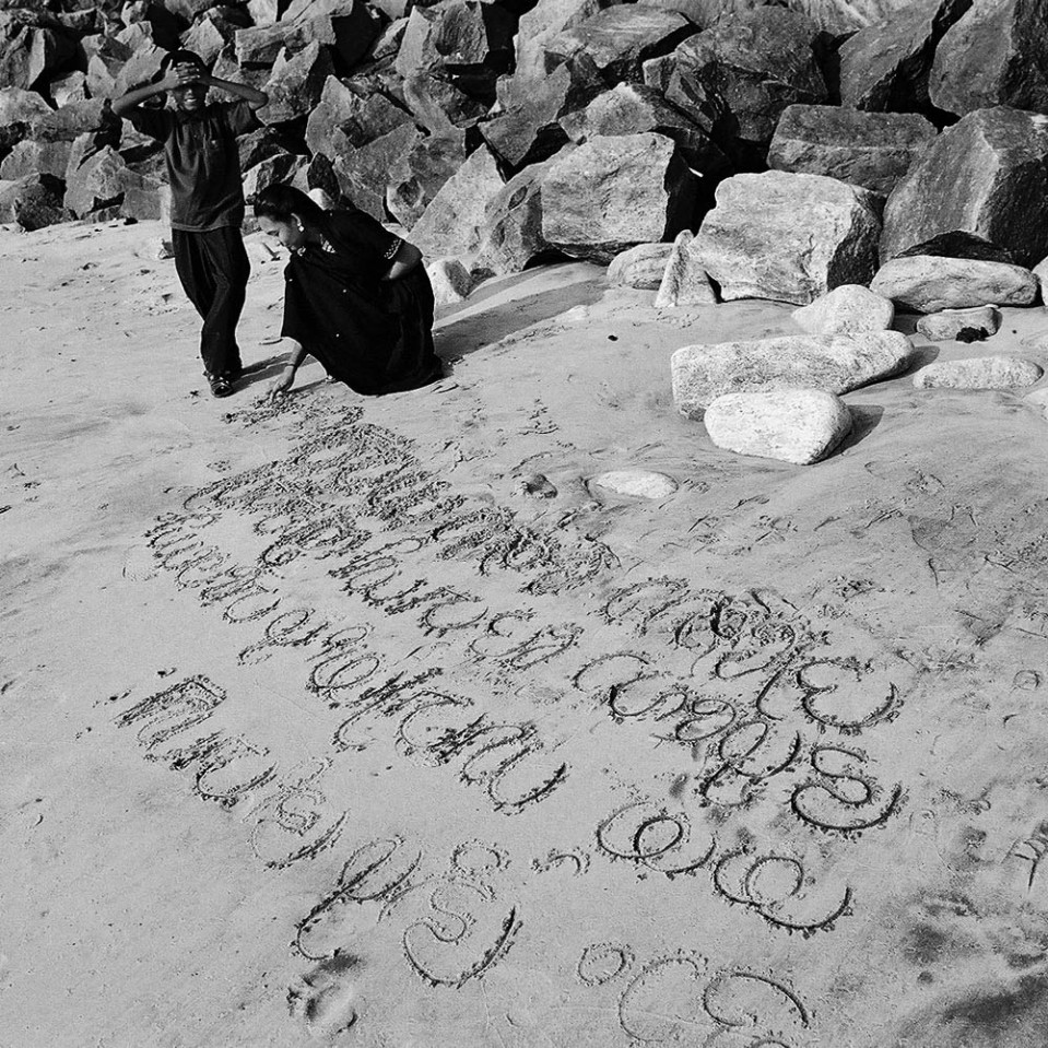 Writing wonders in ancient alphabets on the beach at Varkala.