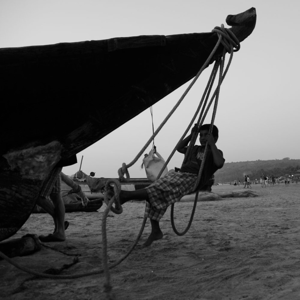 The traditional, all-wood fishing boats, once beached, double nicely as swings.