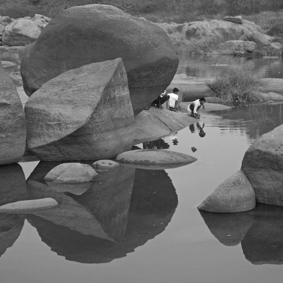 The river banks are littered with huge, circular granite boulders.