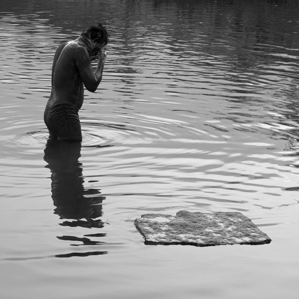 At all hours of the day, people come to bathe - and pray - in the cleansing waters.
