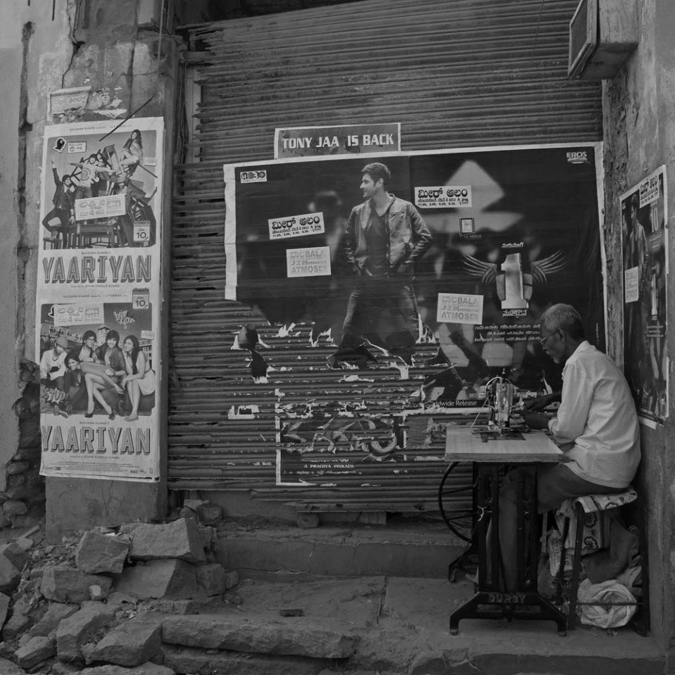 There is at least one tailor, in Hospet. He may not have a proper shop to work in, but he has plenty of paper people pasted to the walls to keep him good company.