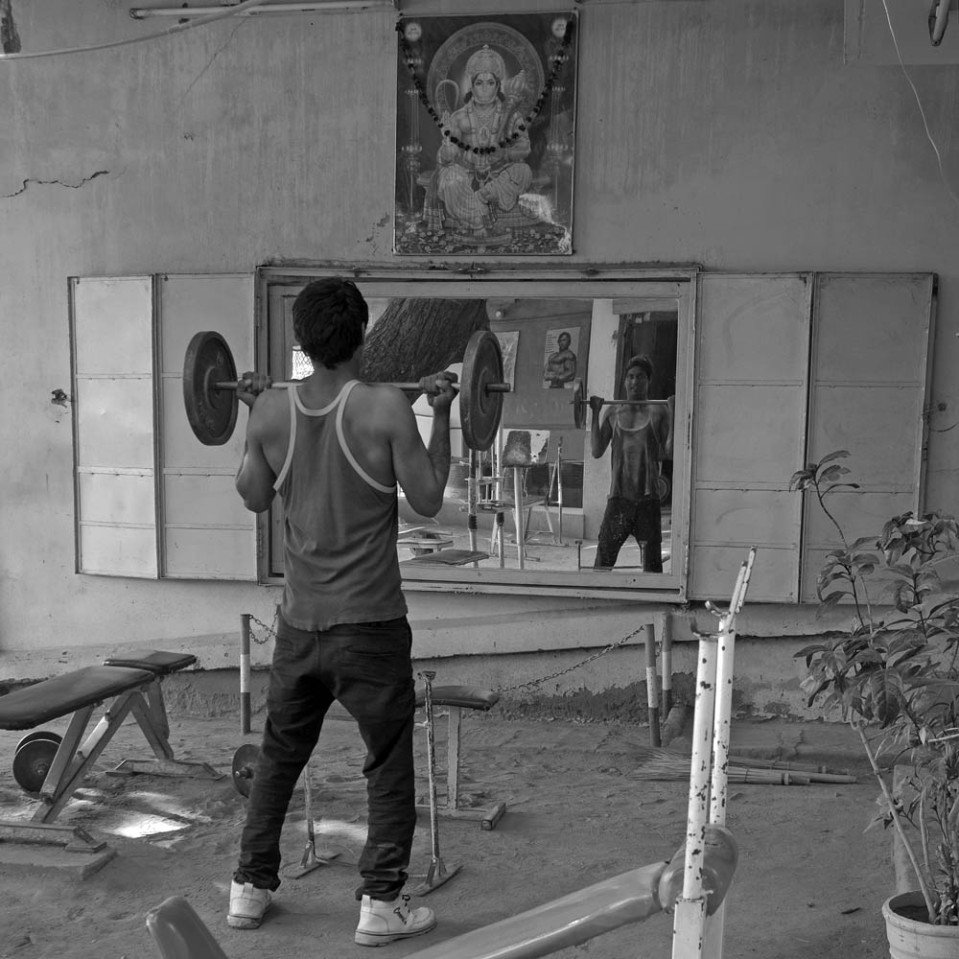 Pop into the local gymnasium, and you might find some skinny dude pumping iron, old school. On the walls, Hindu gods and Arnold Schwarzenegger for motivation.