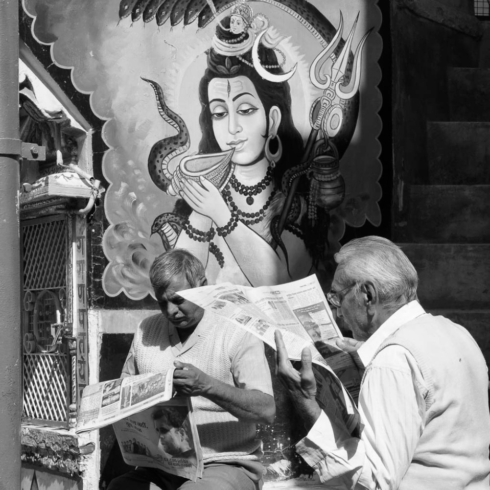 Of course, India's polychromatic pantheon provides endless source of inspiration. Here two gentlemen quietly read th morning papers near a large mural depicting a benevolent Shiva.