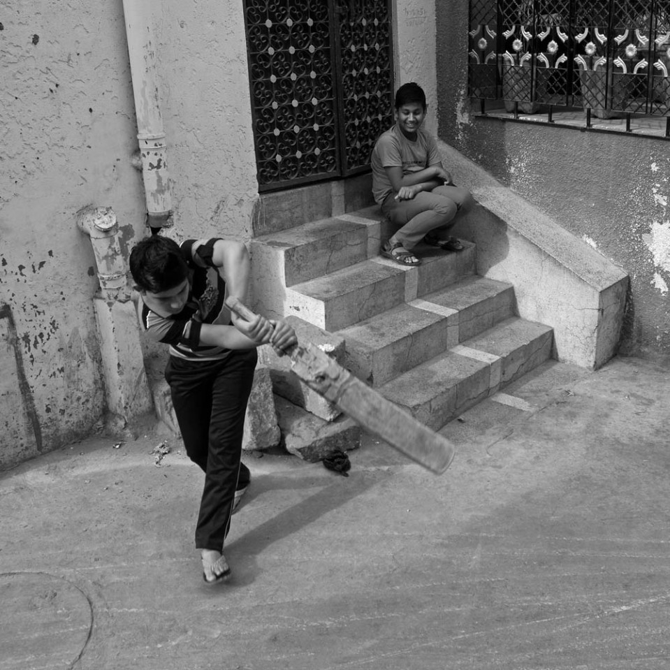 No space is too small for a quick round of cricket. Heck, this narrow alley even comes with bleachers...