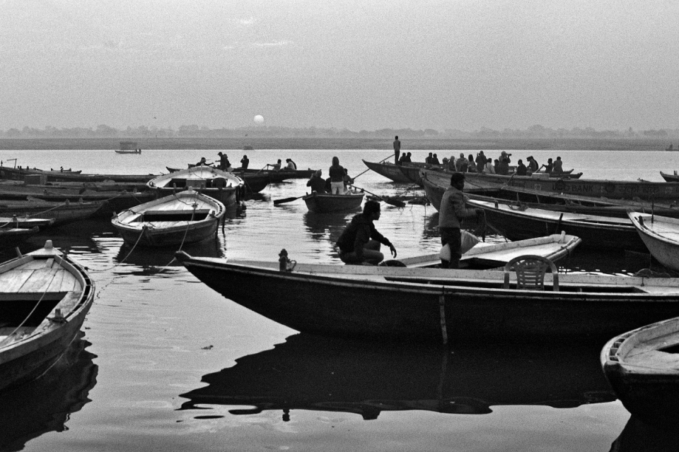 It's the crack of dawn on the banks of the Ganges, but the boats are already bobbing into action along the ghats at Varanasi. As they have for thousands of years.