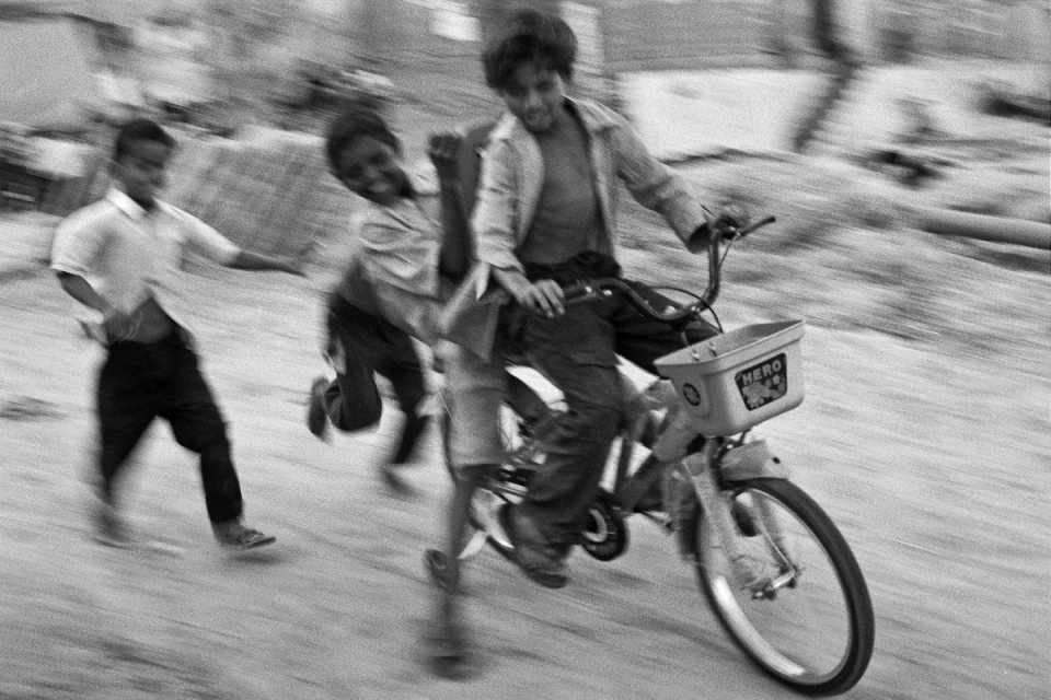 India, where one bicycle can provide endless entertainment for up to four (fast-moving) youngsters.